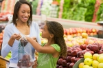 mom-and-daughter-buying-apples_uc90jn