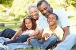 African American Grandparents With Grandchildren In Park