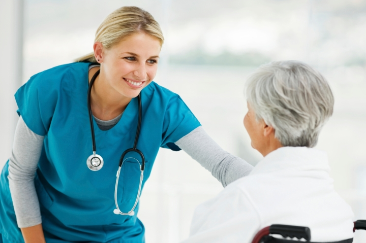 Young Doctor Speaking With an Elderly Patient