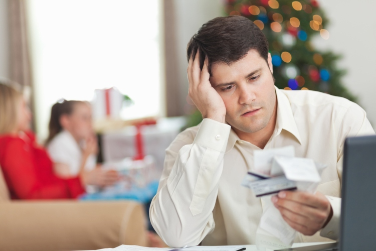Frustrated dad looking at receipts and bills during Christmas time